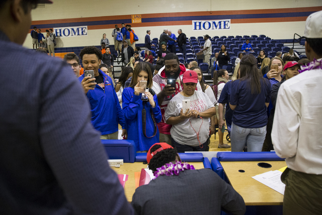 Bishop Gorman football players are photographed by family and friends during Signing Day at Bishop Gorman High School on Wednesday, Feb. 1, 2017, in Las Vegas. (Erik Verduzco/Las Vegas Review-Jour ...