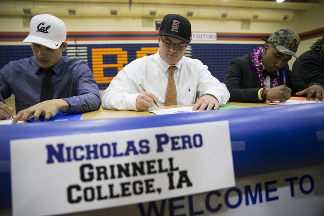 Biaggio Ali Walsh, from left, who committed to attending University of California, Berkeley, Nicholas Pero, who committed to Grinnell College, Iowa, and Alex Perry, who committed to Arizona State  ...