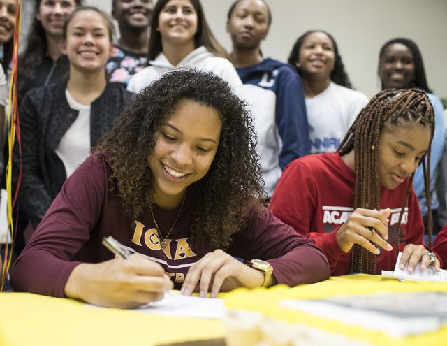 Jayden Eggleston, left, and Megan Jefferson sign a letter of intent at Centennial High School in Las Vegas on Wednesday, Nov. 9, 2016. Eggleston will attend Iona College and Jefferson will attend  ...