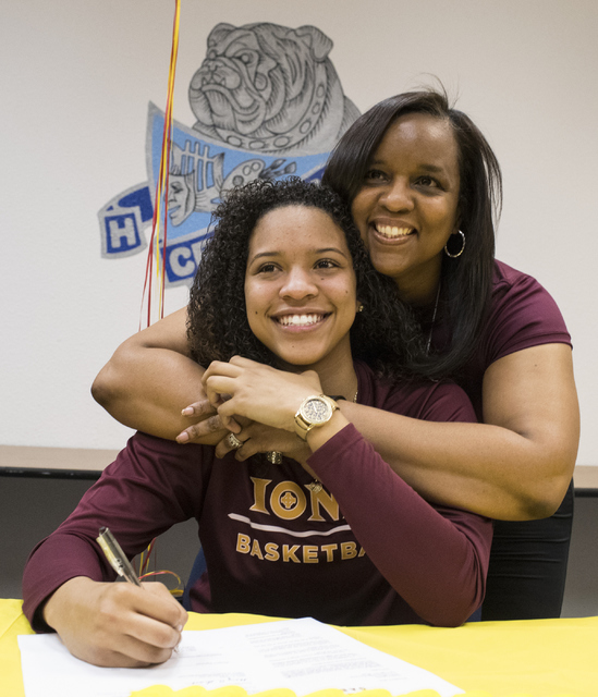 Jayden Eggleston, left, and her mother, Camisha Gathright, pose during a letter signing event at Centennial High School in Las Vegas on Wednesday, Nov. 9, 2016. Eggleston will attend Iona College. ...