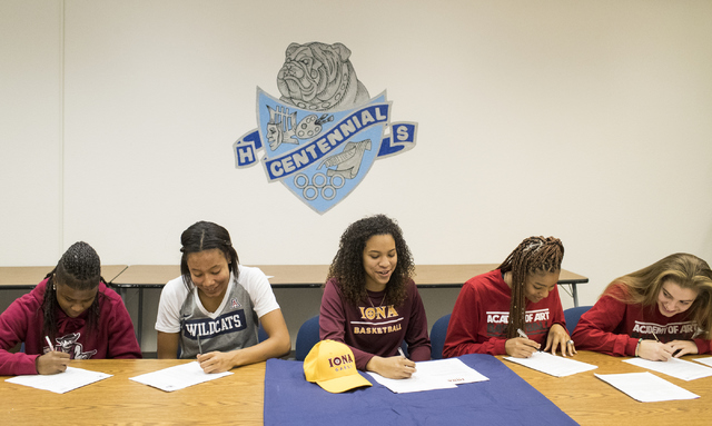 Pam Wilmore, from left, Samantha Thomas, Jayden Eggleston, Megan Jefferson and Shyla Miller sign their letter of intent at Centennial High School in Las Vegas on Wednesday, Nov. 9, 2016. Loren Tow ...