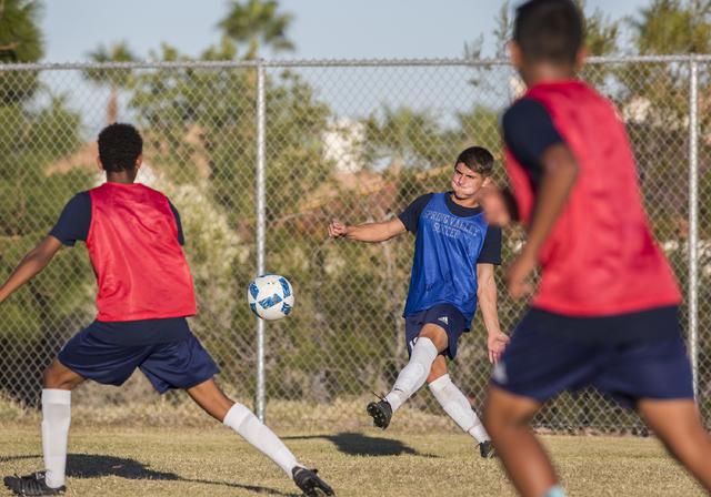 Spring Valley soccer player David Van Hoose, center, makes a pass during practice on Wednesday, Nov. 9, 2016, at Spring Valley High School, in Las Vegas. Benjamin Hager/Las Vegas Review-Journal