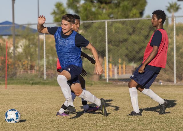 Spring Valley soccer player David Van Hoose, left, makes a run towards goal during practice on Wednesday, Nov. 9, 2016, at Spring Valley High School, in Las Vegas. Benjamin Hager/Las Vegas Review- ...