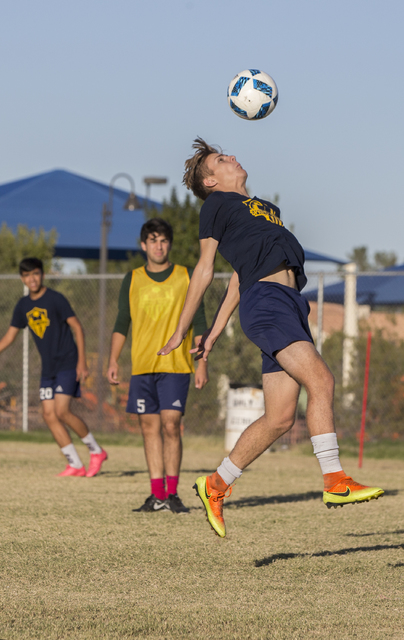 Spring Valley soccer player Ethan Orme (11) goes up for a header during practice on Wednesday, Nov. 9, 2016, at Spring Valley High School, in Las Vegas. Benjamin Hager/Las Vegas Review-Journal