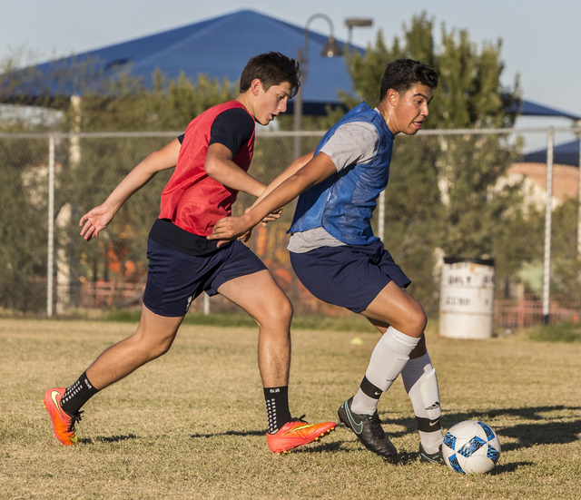 Spring Valley soccer player Jose Lopez, right,  dribbles past a defender during practice on Wednesday, Nov. 9, 2016, at Spring Valley High School, in Las Vegas. Benjamin Hager/Las Vegas Review-Journal