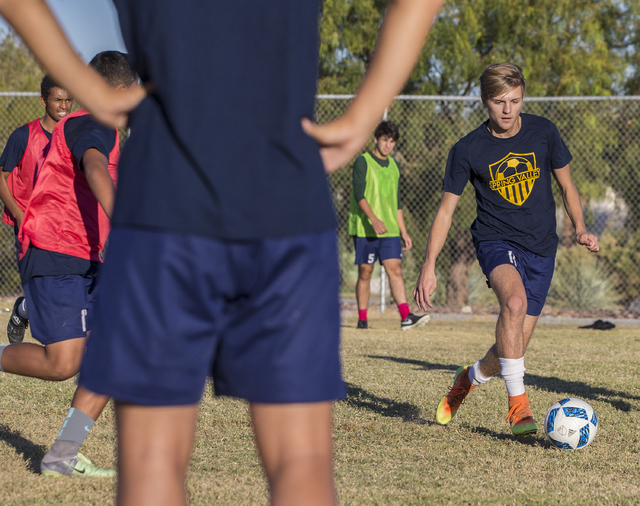 Spring Valley soccer player Ethan Orme (11) dribbles past defenders during practice on Wednesday, Nov. 9, 2016, at Spring Valley High School, in Las Vegas. Benjamin Hager/Las Vegas Review-Journal