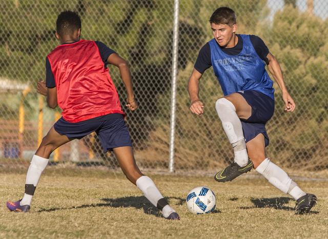 Spring Valley soccer player David Van Hoose, right, sprints past a defender during practice on Wednesday, Nov. 9, 2016, at Spring Valley High School, in Las Vegas. Benjamin Hager/Las Vegas Review- ...