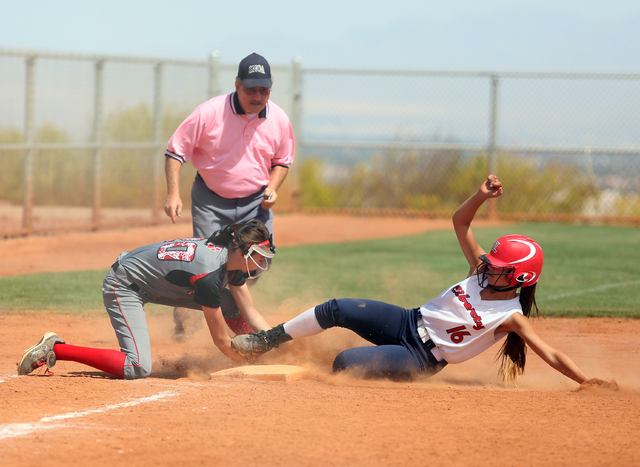 Lincoln County's Easton Tingey, left, tags out Liberty's Ashleigh Rodriguez at third base Thursday during the Spring Jaboree. Liberty won, 4-1. (Ronda Churchill/Las Vegas Review-Journal)