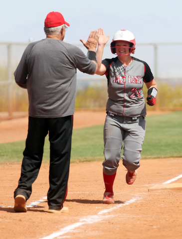 Lincoln County coach Pat Kelley, left, congratulates Aspen Wilkin after she hit a home run against Liberty at the Spring Jamboree. Liberty won, 4-1. (Ronda Churchill/Las Vegas Review-Journal)