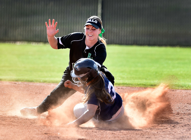 Centennial's Sonja Lawrence (3) is tagged out trying to steal second base against Palo Verde's Kali Tomlinson during a high school softball game at Palo Verde High School on Tuesday, March 10, 201 ...