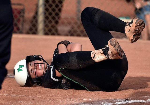 Palo Verde's Cara Beatty grimaces after hitting the ball against Centennial during a high school softball game at Palo Verde High School on Tuesday, March 10, 2015, in Las Vegas. (David Becker/Las ...