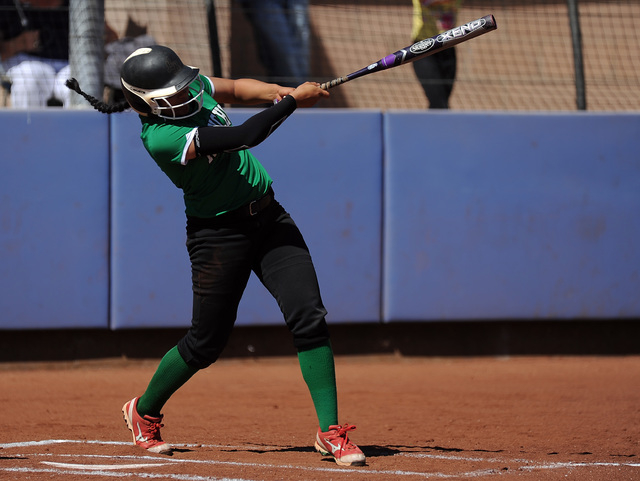 Rancho infielder Tiare Lee hits an RBI double against Bishop Gorman in the first inning of their prep softball game at Bishop Gorman High School in Las Vegas Saturday March 28, 2015. Rancho defeat ...