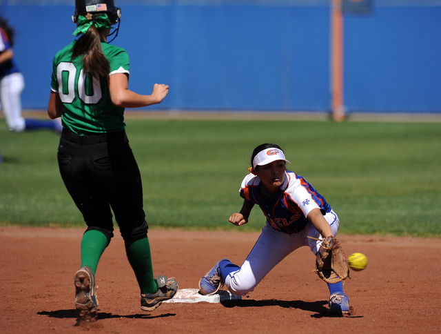 Rancho base runner Sissy Lupton (00) is thrown out by Bishop Gorman shortstop Sierra Dias at second base while trying to advance on a ball hit by Jahnae Davis-Houston (not pictured) in the first i ...