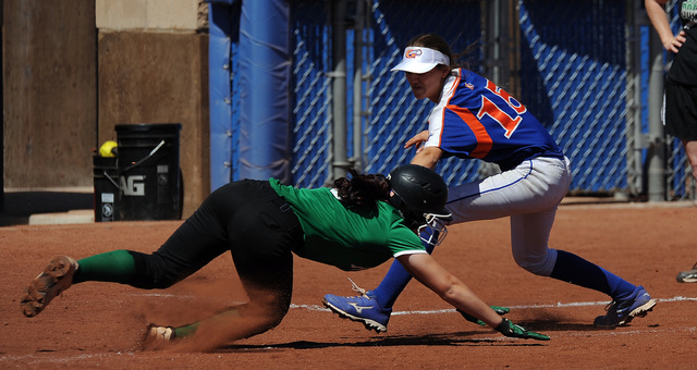 Rancho base runner Gianna Carosone is tagged out by Bishop Gorman third baseman Morgan Blanner at third base after Carosone overran the base on a Rancho base hit in the third inning of their prep  ...