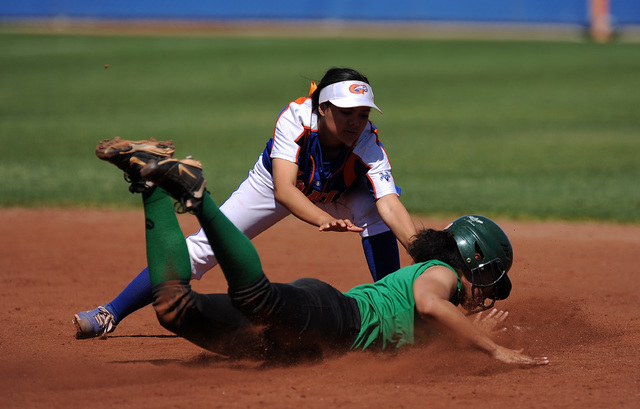 Bishop Gorman shortstop Sierra Dias tags out Rancho base runner Kayla Coles after Coles attempted to steal second base in the fourth inning of their prep softball game at Bishop Gorman High School ...