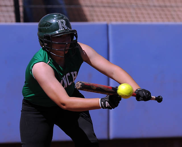 Rancho catcher McKinzi Vega bunts in a run against Bishop Gorman in the first inning of their prep softball game at Bishop Gorman High School in Las Vegas Saturday March 28, 2015. Rancho defeated  ...