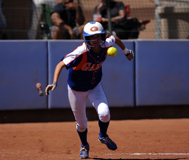 Bishop Gorman player Monique Passalacqua bunts her way to first base against Rancho in the fourth inning of their prep softball game at Bishop Gorman High School in Las Vegas Saturday March 28, 20 ...