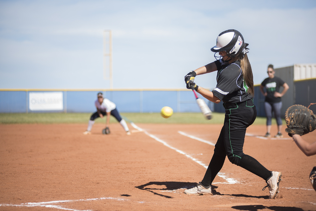 Palo Verde High School's Mackenzie McBride (18) swings at a pitch against Centennial High School during their softball game played at Centennial's softball field in Las Vegas on Friday, April 17,  ...