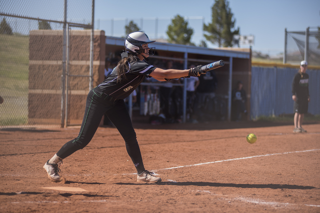 Palo Verde High School's Cara Beatty (5) bunts at a pitch against Centennial High School during their softball game played at Centennial's softball field in Las Vegas on Friday, April 17, 2015. (M ...
