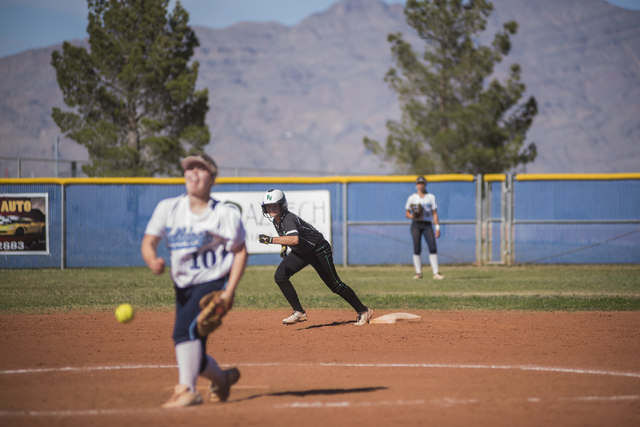 Centennial High School's Maddie Jones (10) pitches against Palo Verde while Palo Verde High School's Mackenzie McBride takes a lead at second base during their softball game played at Centennial's ...