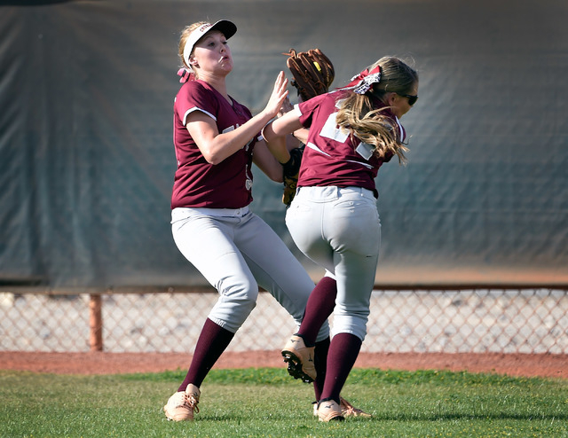 Faith Lutheran's Mosie Foley, left, and Breanna Hemphill collide in the outfield during a high school softball game against Sierra Vista at Faith Lutheran High School on Monday, April 20, 2015, in ...