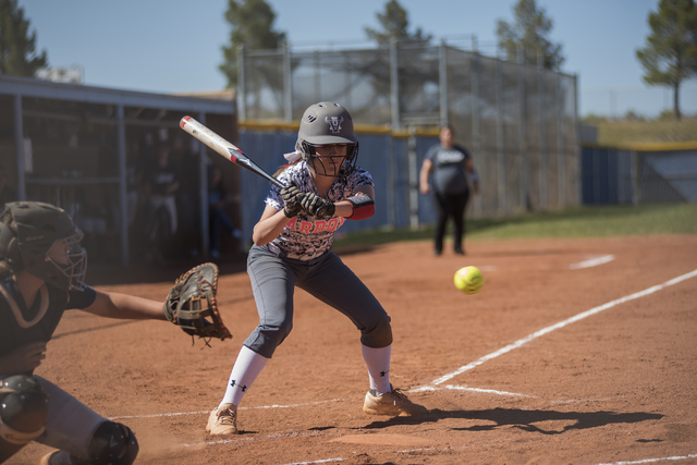 Arbor View's Breanne Henricksen (4) looks at a pitch against Centennial during their softball game played at Centennial's softball field in Las Vegas on Tuesday, April 28, 2015. Centennial won, 5- ...