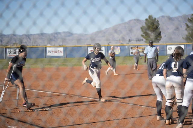 Centennial's Ava Dolan (16) runs to home plate as teammates wait to congratulate her for hitting a home run against Arbor View during their softball game played at Centennial's softball field in L ...