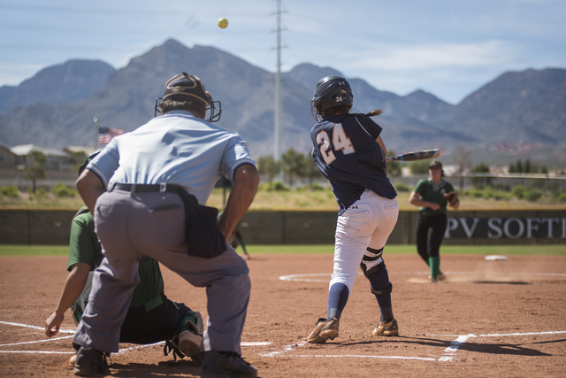 Shadow Ridge's Justin Garganese (24) hits the ball against Palo Verde during a softball game played at Palo Verde softball field in Las Vegas on Wednesday, April 29, 2015. Palo Verde won, 4-1. (Ma ...
