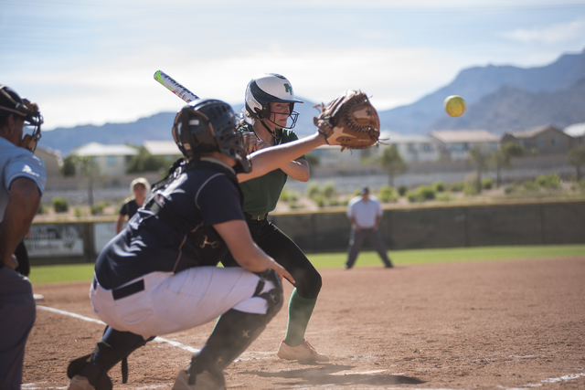 Palo Verde's Makall Whetten (1) takes a look at a pitch against Shadow Ridge during a softball game played at Palo Verde softball field in Las Vegas on Wednesday, April 29, 2015. Palo Verde won, 4 ...