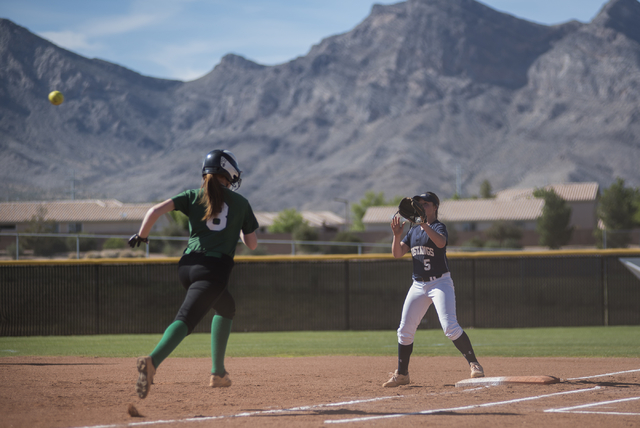 Shadow Ridge's Samantha Milanovich (5) receives the ball for an out at first against Palo Verde during a softball game played at Palo Verde softball field in Las Vegas on Wednesday, April 29, 2015 ...