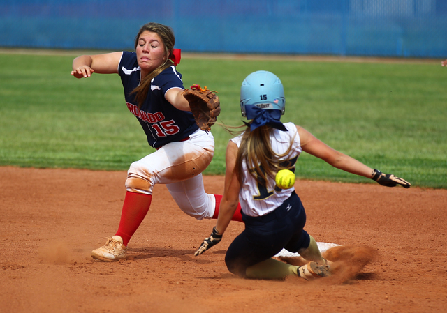 Foothill's Hannah Stevens (15) slides safely into second as Coronado's Danielle Amato (15) can't come up with the throw on Wednesday. The Falcons won, 8-7. (Chase Stevens/Las Vegas Review-Journal)