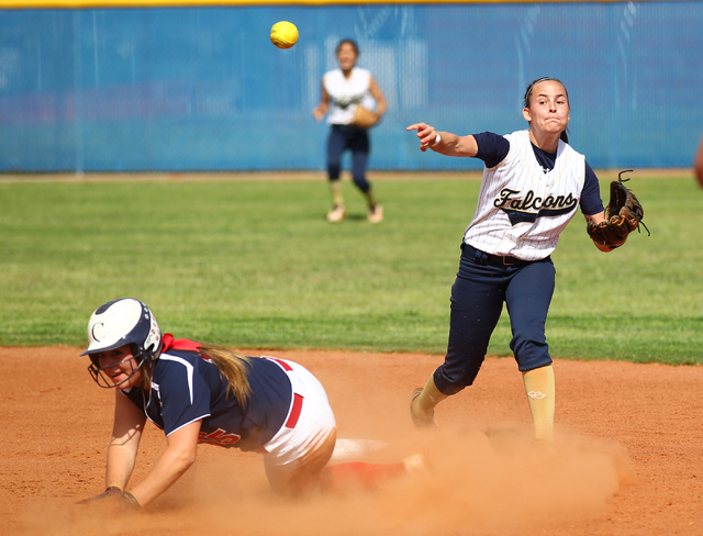 Foothill's RaeAnn Brems throws to first after forcing out Coronado's Danielle Amato (15) on Wednesday. The Falcons won, 8-7. (Chase Stevens/Las Vegas Review-Journal)