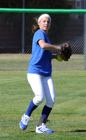 Green Valley girls softball center fielder Maggie Manwarren throws the ball back to the infield at a recent practice. Manwarren hit .531 last season and is also a standout on the basketball team.  ...