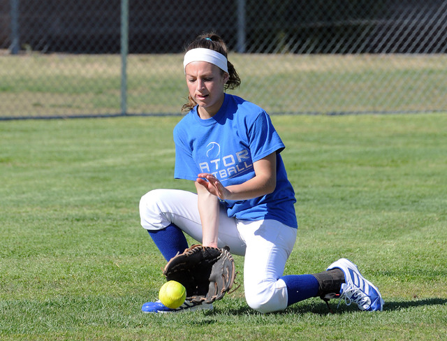 Green Valley girls softball center fielder Maggie Manwarren fields a grounder at a recent practice. Manwarren hit .531 with 20 stolen bases last season. (Jerry Henkel/Las Vegas Review-Journal)