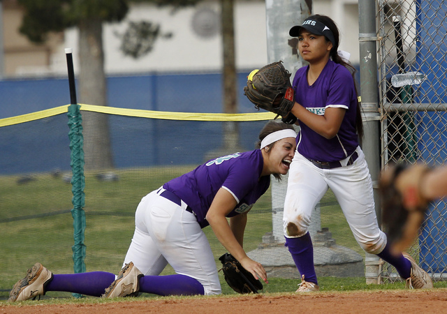 Silverado's Arieana Monturio (2) makes a catch in foul territory to record an out as teammate Heaven Calhoun (24) reacts. The Skyhawks knocked off Green Valley, 4-2. (Jason Bean/Las Vegas Review-J ...