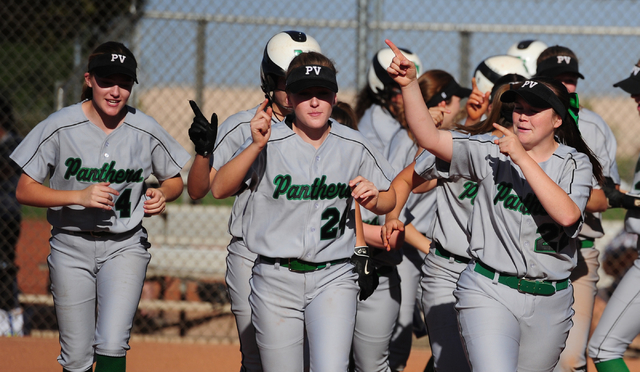 Palo Verde players celebrate after scoring two runs in the third inning to even up the score at 3-3 during their prep softball game against Centennial at Palo Verde High School in Las Vegas Wednes ...