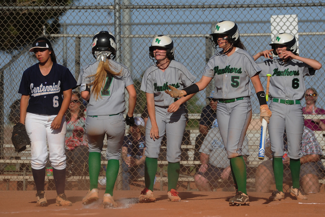 Palo Verde batter Cara Beatty (5) greets Camden Zahn (7) at home plate after three runs were scored in the fourth inning of their prep softball game  against Centennial at Palo Verde High School i ...