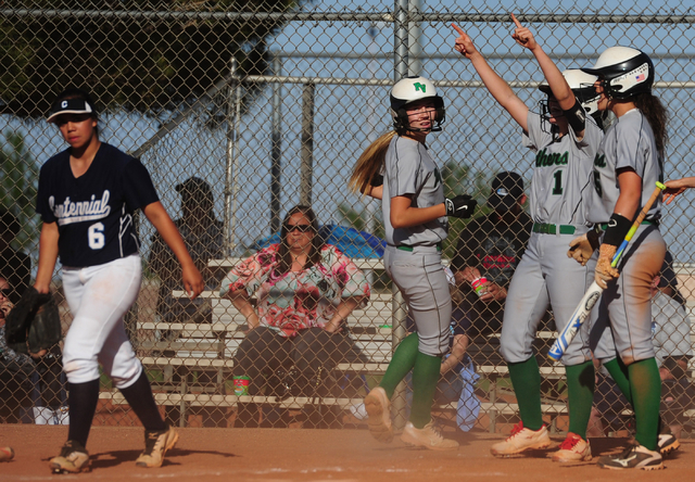 Palo Verde base runner McKenzie Ryan (1) celebrates after three runs were scored while Centennial pitcher Deanna Barrera (6) reacts in the fourth inning of their prep softball game against Centenn ...