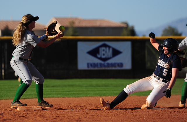 Palo Verde shortstop Lauryn Barker attempts to turn a double play while Centennial base runner Stephanie Day (5) slides into second base in the sixth inning of their prep softball game at Palo Ver ...