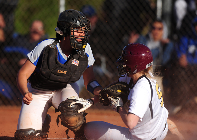 Faith Lutheran base runner Mosie Foley (5) scores the game's tying run ahead of the tag by Sierra Vista catcher Mia Buranamonti in the seventh inning of their prep softball game at Faith Lutheran  ...