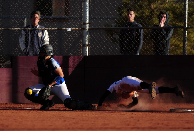 Faith Lutheran base runner Ellie Fried scores the game's winning run as Sierra Vista catcher Mia Buranamonti fields the late throw in the eighth inning of their prep softball game at Faith Luthera ...