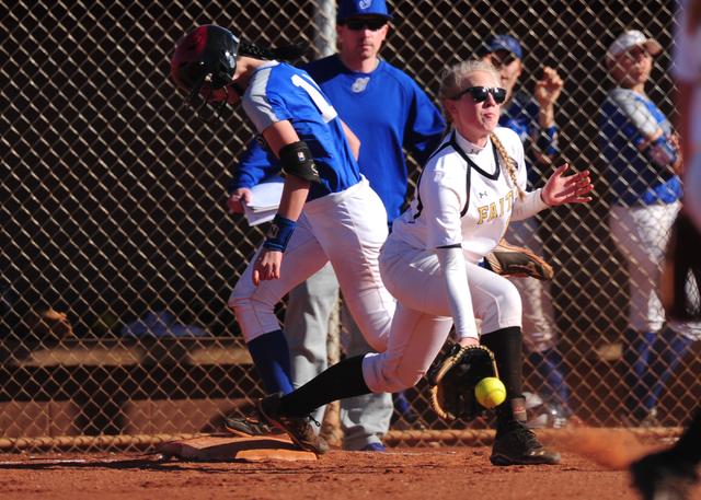 Sierra Vista base runner Daelynn Hilton beats the throw fielded by Faith Lutheran first baseman Samantha Jack during their prep softball game at Faith Lutheran High School in Las Vegas Tuesday, Ma ...