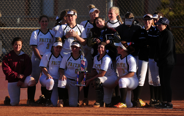 Faith Lutheran players pose with the trophy after defeating Sierra Vista 2-1 in eight innings during their prep softball game at Faith Lutheran High School in Las Vegas Tuesday, March 22, 2016. Fa ...