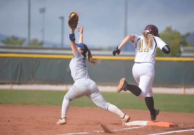 Sierra Vista's Brendee Ford (9) catches the ball for an out at first base against Faith Lutheran's Haley Jack (17) during their softball game played at Faith Lutheran's Sam Boyd softball field in  ...