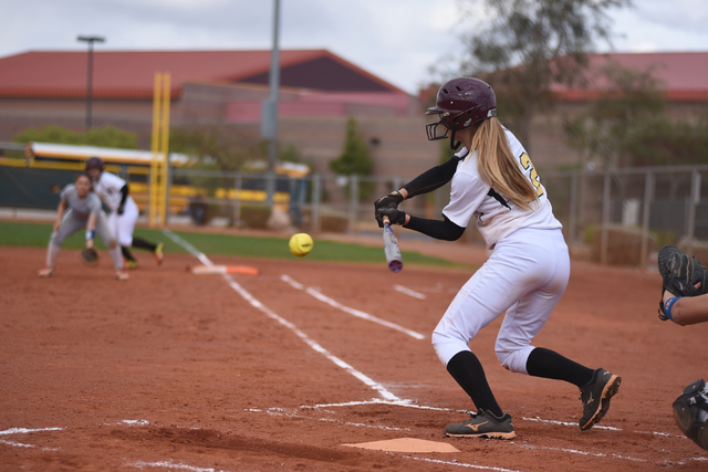 Faith Lutheran's Ellie Fried (12) swings at a pitch against Sierra Vista during their softball game played at Faith Lutheran's Sam Boyd softball field in Las Vegas on Tuesday, March 29, 2016. Sier ...
