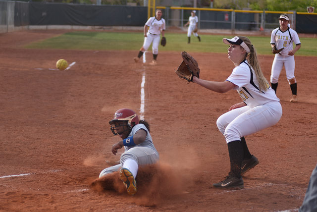 Sierra Vista's Harmony Dominguez (14) slides at home for a run against Faith Lutheran during their softball game played at Faith Lutheran's Sam Boyd softball field in Las Vegas on Tuesday, March 2 ...