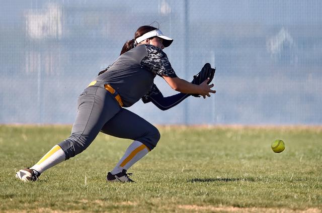 Boulder City outfielder Jeanne Carmell misses a fly ball during a high school softball game against Sierra Vista at Sierra Vista High School Monday, April 4, 2016, in Las Vegas. Sierra Vista won 7 ...