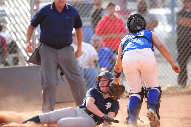 Sierra Vista catcher Mia Buranamonti tags out Spring Valley base runner Michaela Hood at home plate in the seventh inning of their prep softball game at Sierra Vista High School in Las Vegas Wedne ...