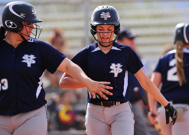 Spring Valley Teegan Teal, center, high fives Raven Bierlein after scoring a run against Sierra Vista in the third inning of their prep softball game at Sierra Vista High School in Las Vegas Wedne ...