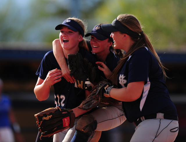 Spring Valley's Mariah Ward, middle, and Stephanie Huff, right, congratulate starting pitcher Michaela Hood after the Grizzlies defeated Sierra Vista 6-1 during their prep softball game at Sierra  ...
